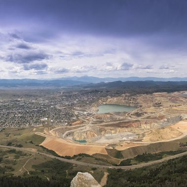 10 wide angle shots stitched together to form a panorama of Butte, MT including the Berkeley Pit. As seen from the feet of Our Lady of the Rockies, elevation 8510 feet above sea level and looking down on the town of Butte, Mt. Our Lady of the Rockies is behind where I'm standing to take this picture.  Many of my photos are for sale, please click over to my photography store and take a peek. I have something for just about anyone who loves nature.