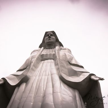 Atop the continental divide in Butte, Mt at an elevation of 8,510 feet above sea level is a 90 foot steel statue of the Virgin Mary. Tours run daily and consist of a 45 minute drive from Butte itself up the 90/15 freeways to get to the turn off, then 7 times passing over the continental divide back and forth along switchbacks to get up to the statue. Tours are about $20 per person and are well worth it. All the pieces had to be flown by helicopter 3,000 feet above Butte on March 19, 1985. My girlfriend who was born and raised in Butte said it was a sight to see these huge and massive steel pieces of the statue being flown into place. On one section the updrafts were so strong, that the helicopter got blown off and one of the hands was bent up when it came into contact with the base of the statue already on the ground. If you're in Butte, or going through it, definitely a must see. (see the panorama from Our Lady's feet looking out over the city of Butte in my photos).  Many of my photos are for sale, please click over to my photography store and take a peek. I have something for just about anyone who loves nature.