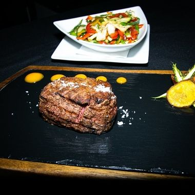a prime Argentinian sirloin steak cooked to perfection served with some sautéed vegetables