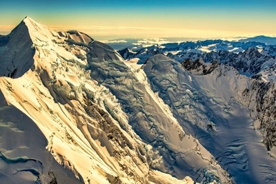Light and shade on the  cliff faces in the snow covered peaks of New Zealand's Southern Alps