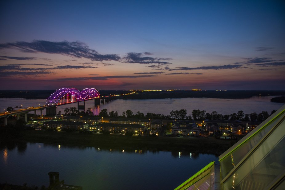 A sunset shot of the bridge that crosses the Mississippi River from the observation deck a top th...