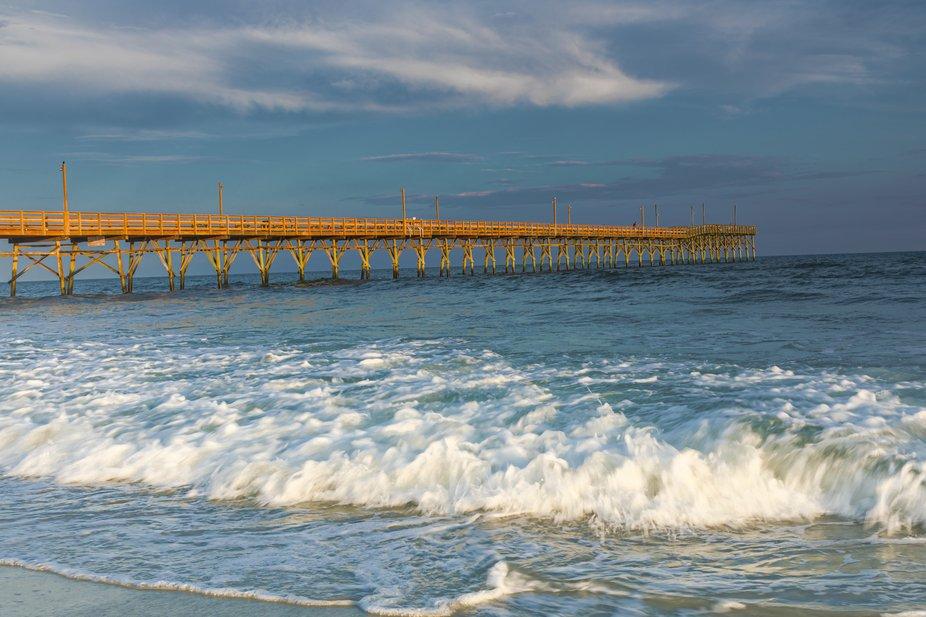 Setting sun light highlighting pier on Sunset beach