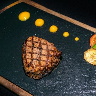 a chargrilled Argentinian fillet steak served on a flint chopping board