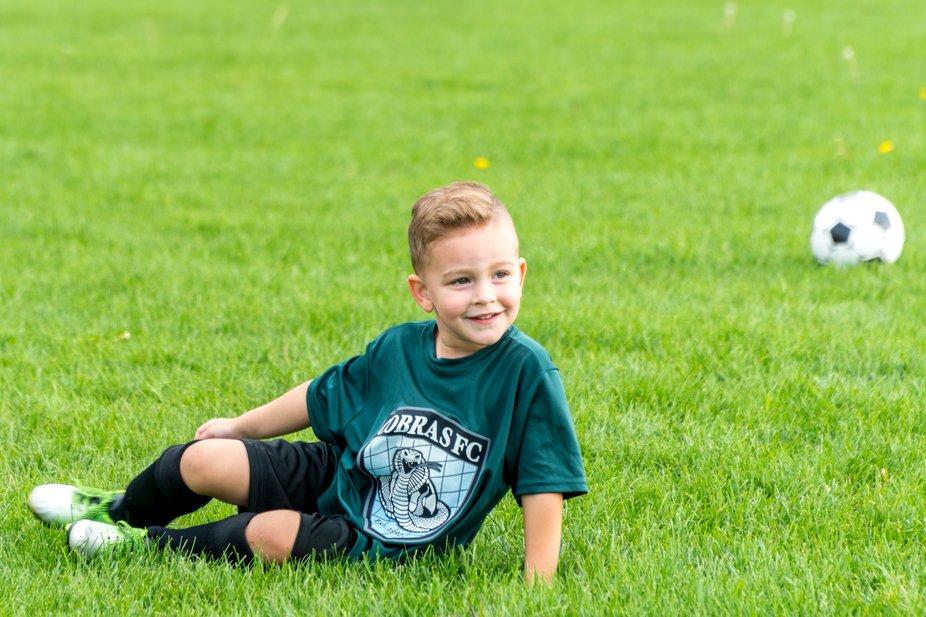 my grandson taking a break during soccer practice