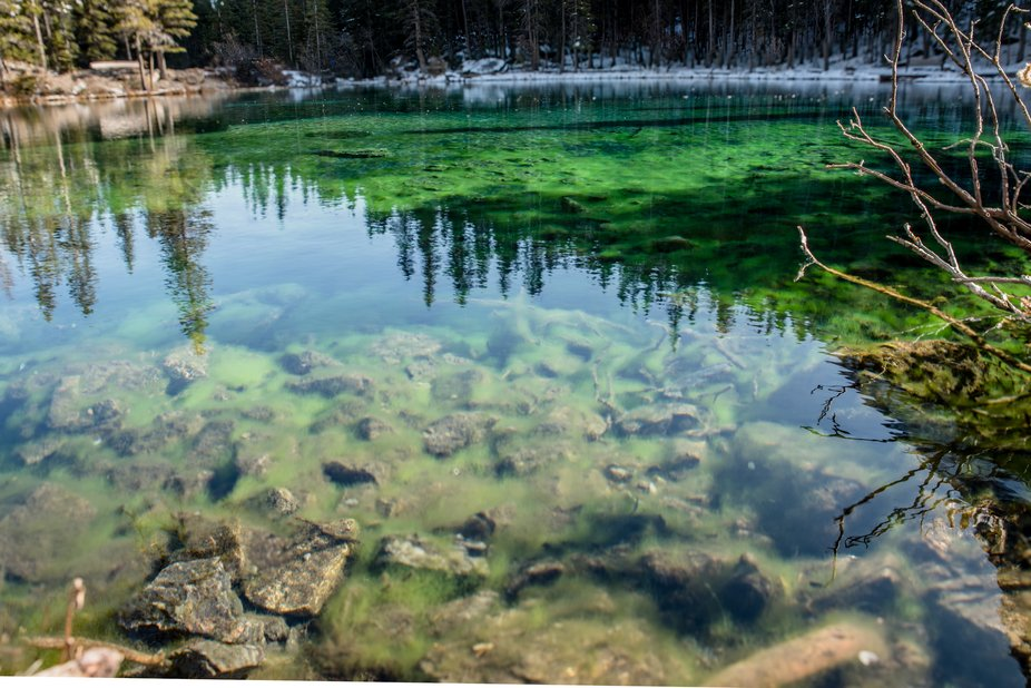 This lake is so clear you can see both right to the bottom and the reflection of it's su...
