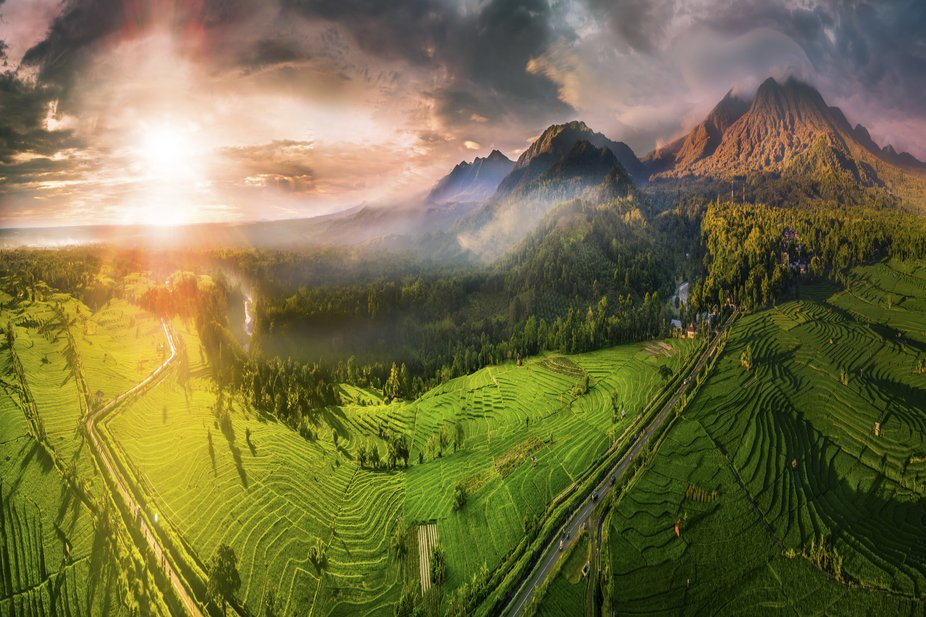 aerial photographs of extraordinary mountains with fog and clouds, incredible sky, the sun that s...