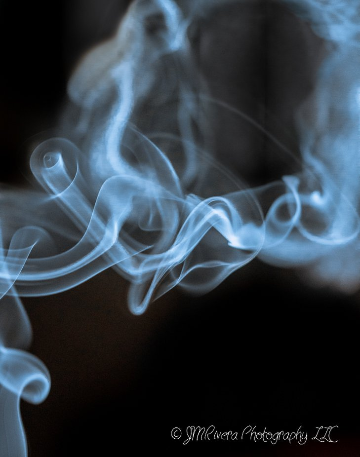 Created using my macro lense and an incense stick and gently blowing on the smoke.