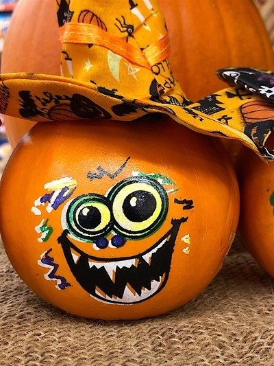 Ornamental Pumpkins with Faces Painted on Them