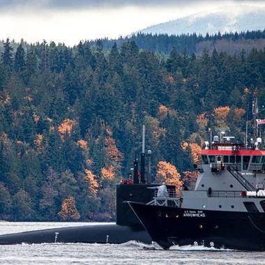 US Submarine with Navy Escort
