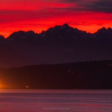 A seiner fishing vessel with the Olympic mountains, Mt. Constance. It was the perfect ending to the day. Hood Canal, Washington, USA