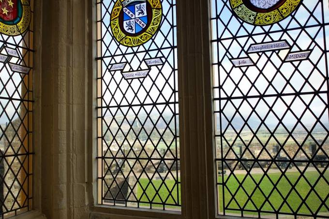 The Walace Monument seen through the stained glass windows of the Great Hall at Stirling Castle.