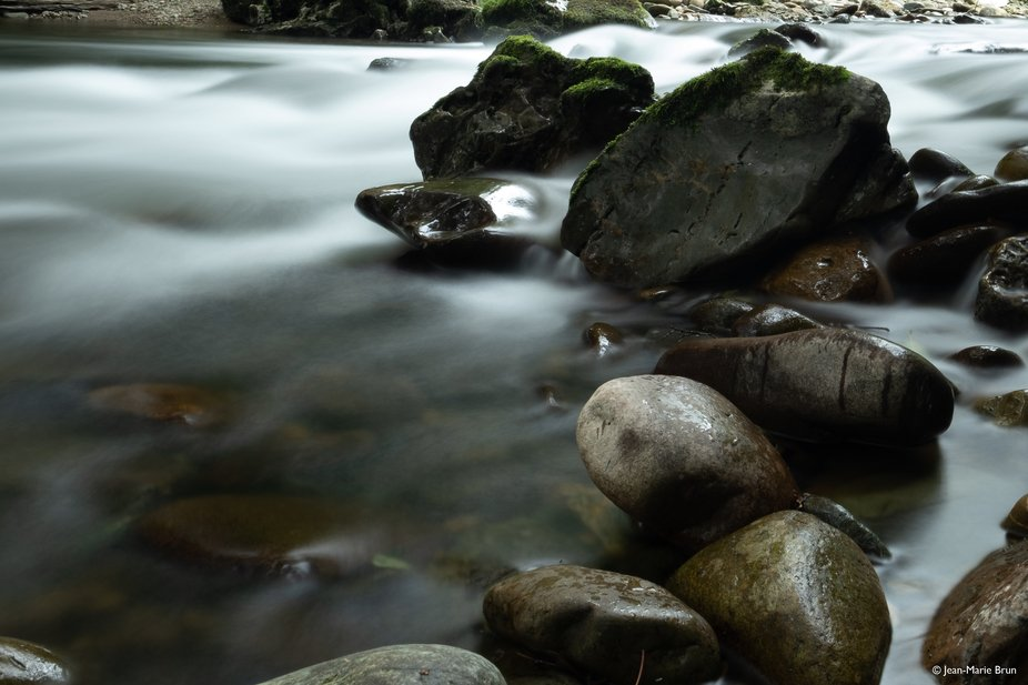 """A long exposure of """"Le Laurhibar"""", a mountain stream of the French """"Pa..."""