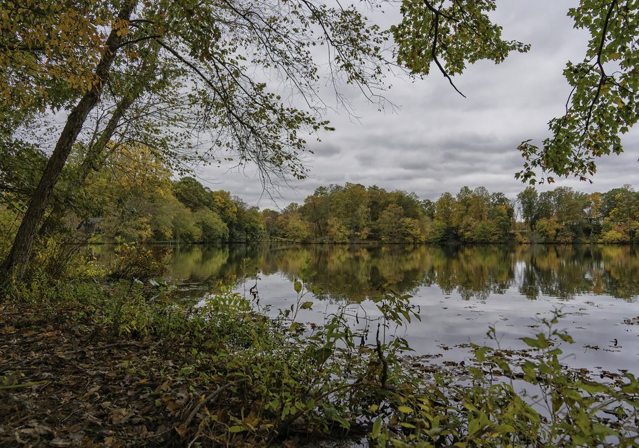 Stopping by the side of the road to take a picture of a pond during the fall. Found a fisherman&a...