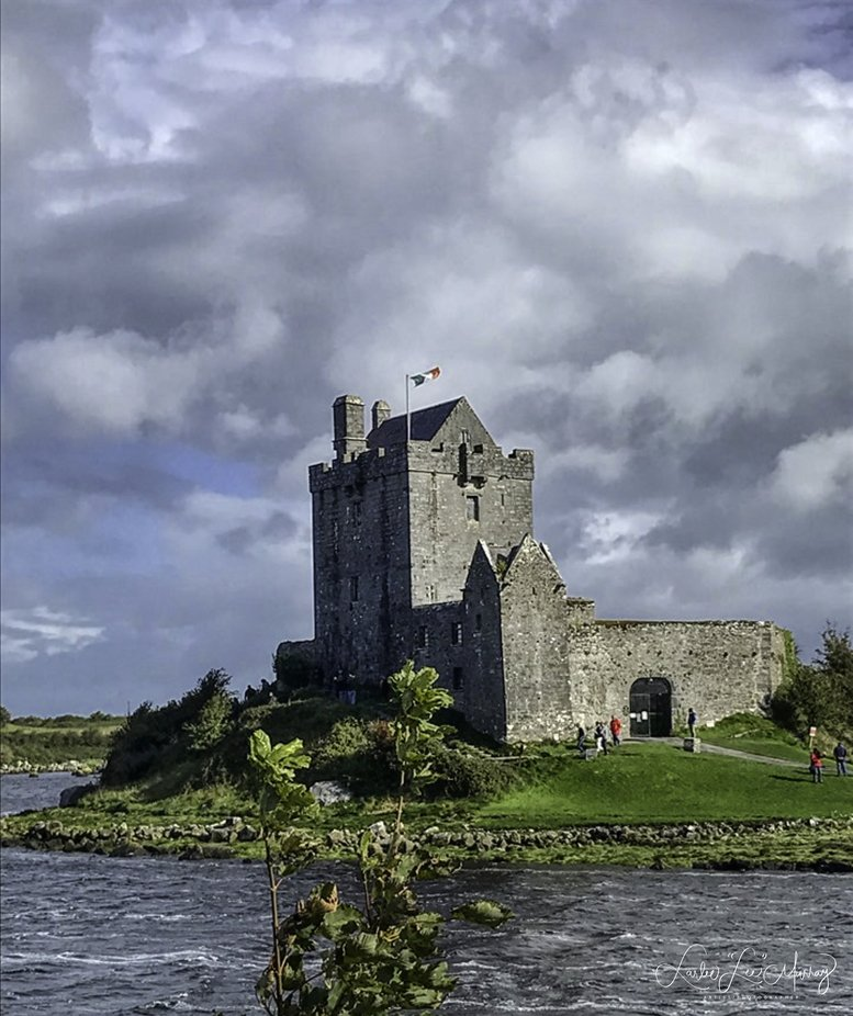 cold windy day with storm coming in - you can see white caps on the water surrounding the castle