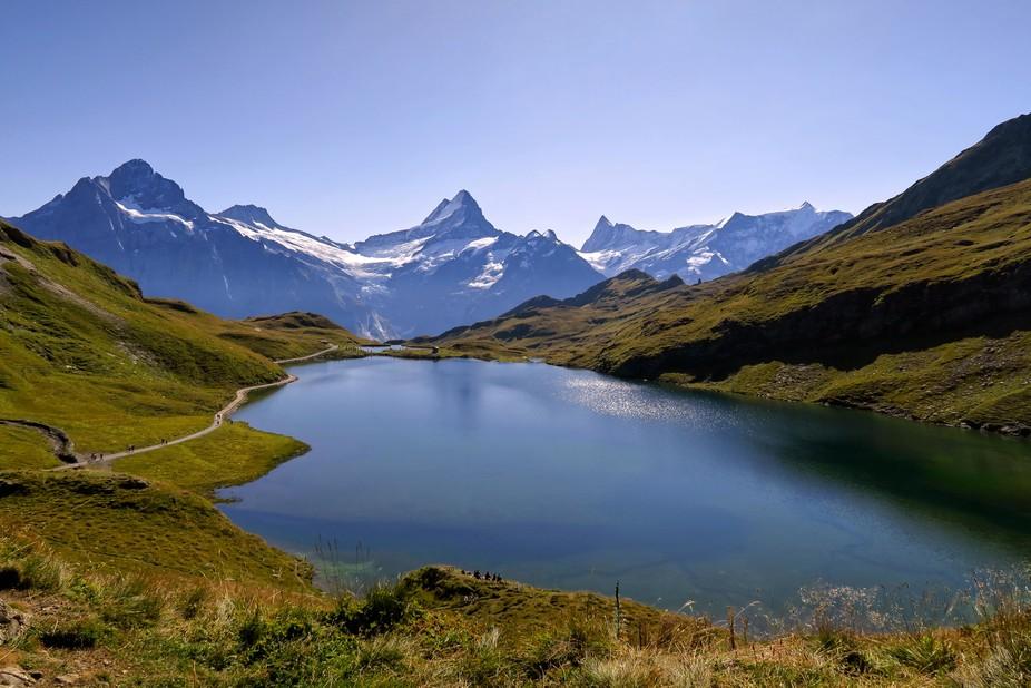 A picture postcard, but beautiful even so... The mountains (L-R) are the Wetterhorn Schreckhorn, Finsteraarhorn and Fiescherhorn