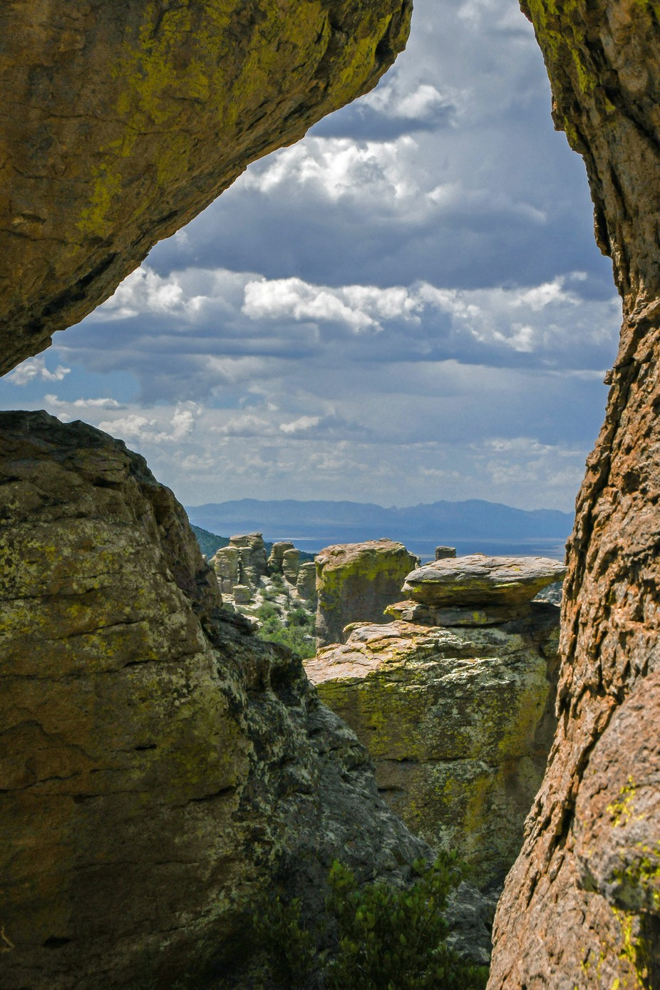Looking through boulders at the beautiful view of Chiricahua National Monument at Massai Point.