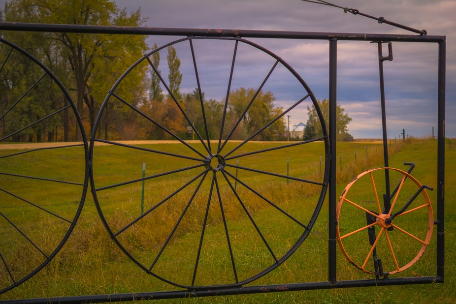 You just gotta love custom made things; like this gate made of wagon wheels.  This gate is at bot...