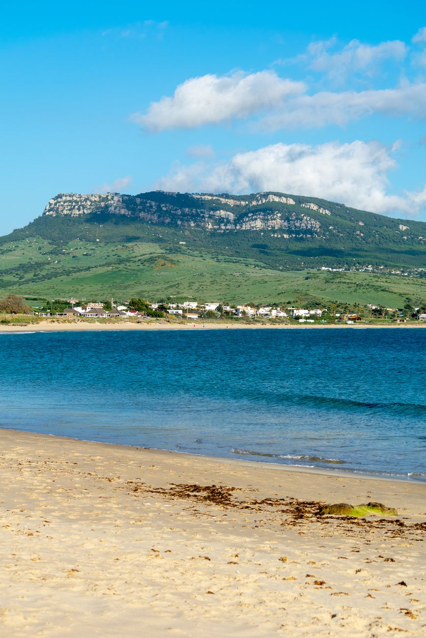 a view of one of the mountain peaks and beach seen from Bolonia beach in Cadiz, Spain