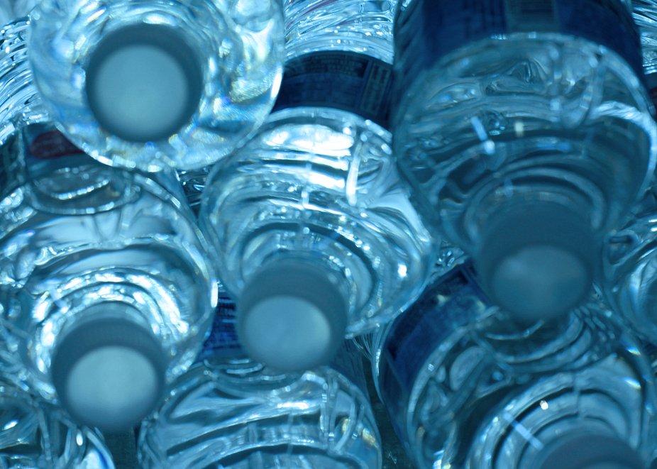 Water bottles looking mysterious in the sales fridge