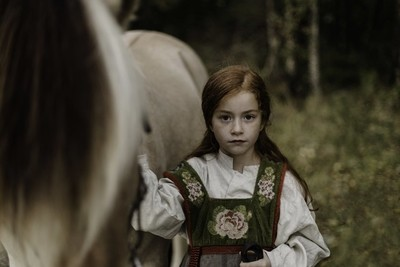 Girl and fjord horse