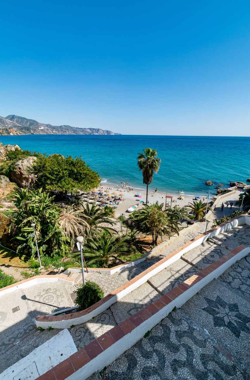 a view including path leading to one of the beaches found in Nerja, Spain