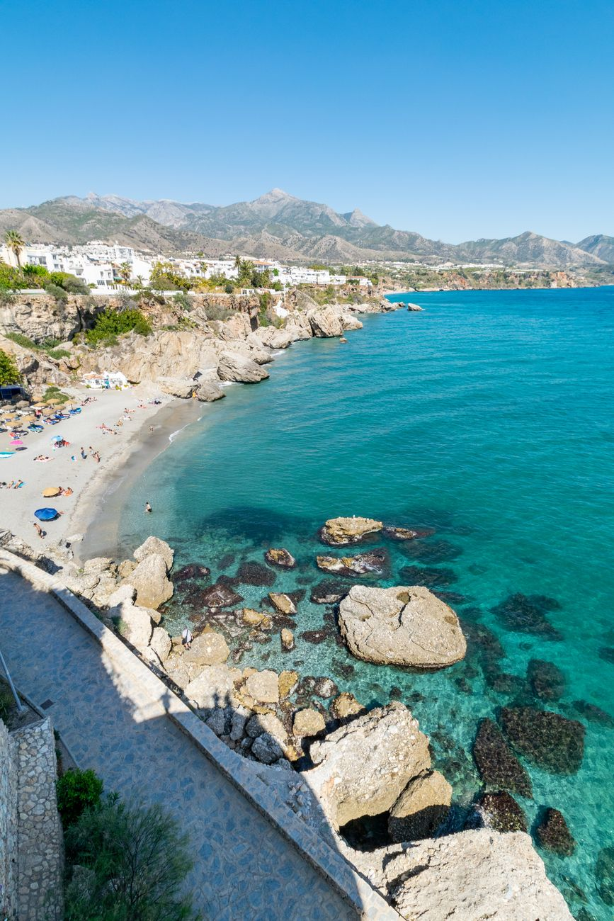 amazing crystal blue waters alongside one of the beautiful bays found in Nerja, Spain