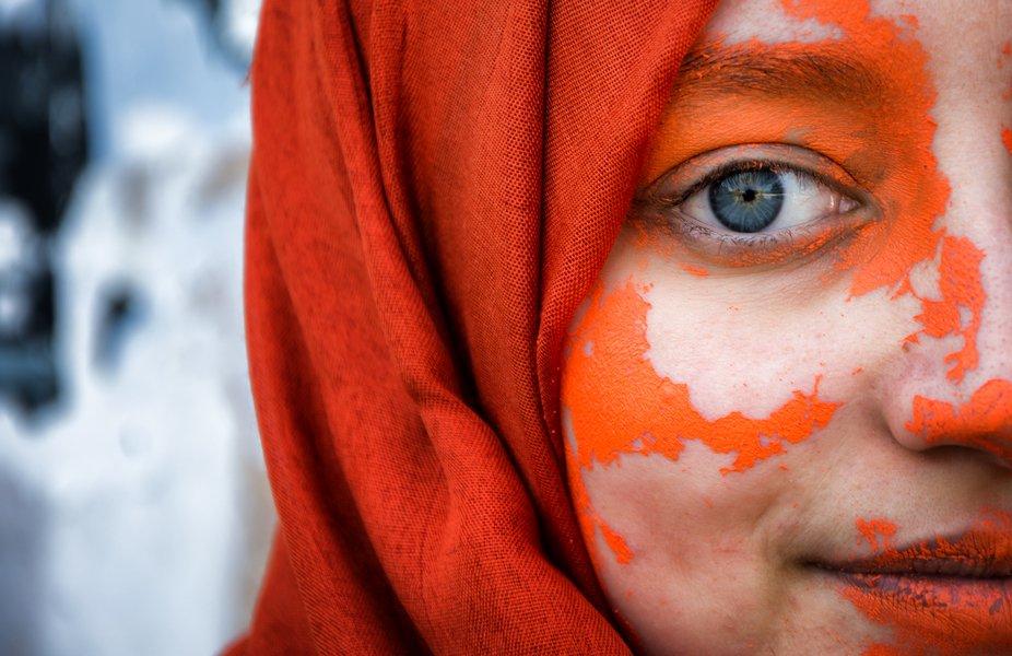 blue eyes girl and orange on skin