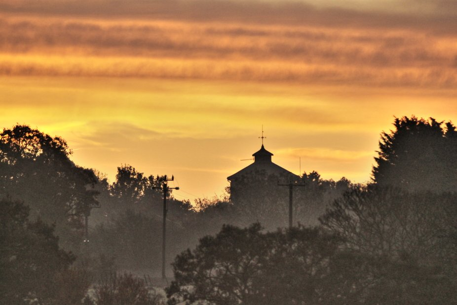 HDR Manipulation of the Sunrise over The Water Tower at Bocking, Essex, England