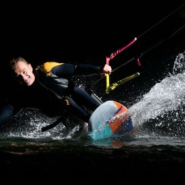 "Thierry Schmitter is a kitesurfer who's not stopped by sitting in a wheelchair, his skills are impressive! He straps himself to a seat mounted to his kiteboard (""sit-kite""). We attached a flash to the lines for an evening session on the water in the ""Zandmotor"", The Hague, the Netherlands. It was fun, we only stopped when it was too dark to focus the camera.