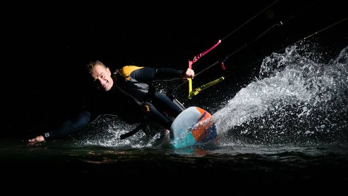 """Thierry Schmitter is a kitesurfer who's not stopped by sitting in a wheelchair, his skills are impressive! He straps himself to a seat mounted to his kiteboard (""""sit-kite""""). We attached a flash to the lines for an evening session on the water in the """"Zandmotor"""", The Hague, the Netherlands. It was fun, we only stopped when it was too dark to focus the camera. 20181002 492.JPG"""