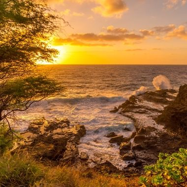 Waves crashing while the morning sun is rising on the Ka'iwi Coast, Honolulu, Hawaii.