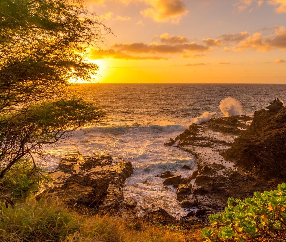 Waves crashing while the morning sun is rising on the Ka'iwi Coast, Honolulu, Hawaii.