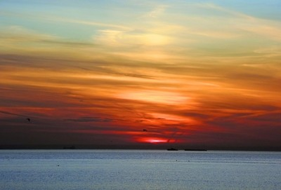The sky is the color of a rainbow. Sunset over the Gulf of Finland. Saint-Petersburg. Photo 01.