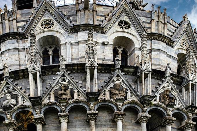 The amazing detail of the masonery  only evident in telephoto of the Baptistery at Pisa