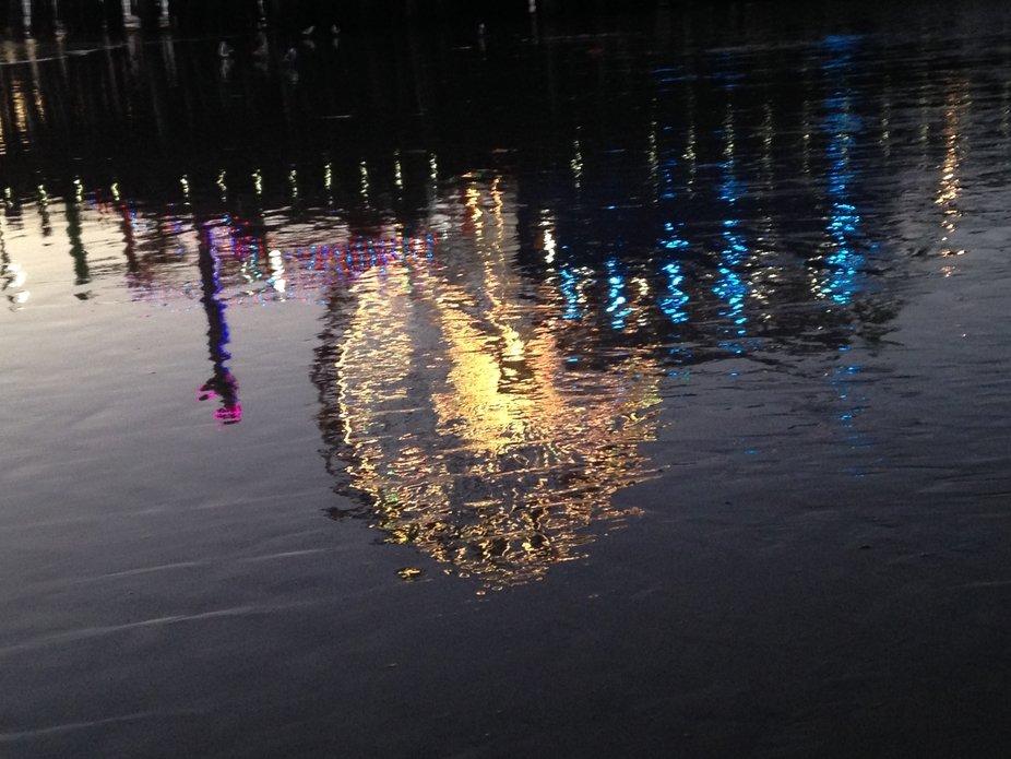 Ocean reflection of the ferris wheel on Santa Monica pier