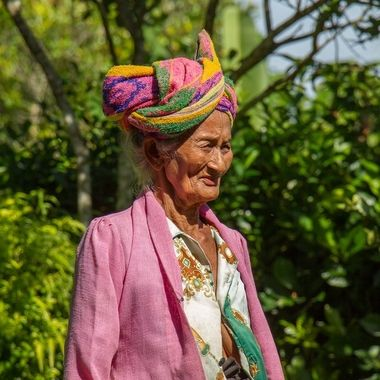 Old balinese woman with gracefully tied cloth on her head