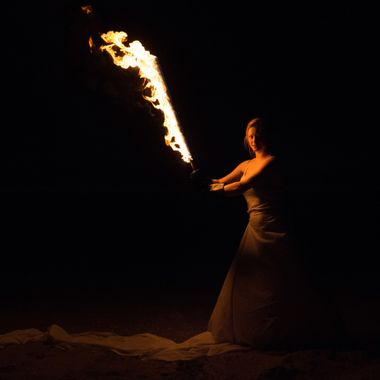 Shoot with a fire sword on the beach. 