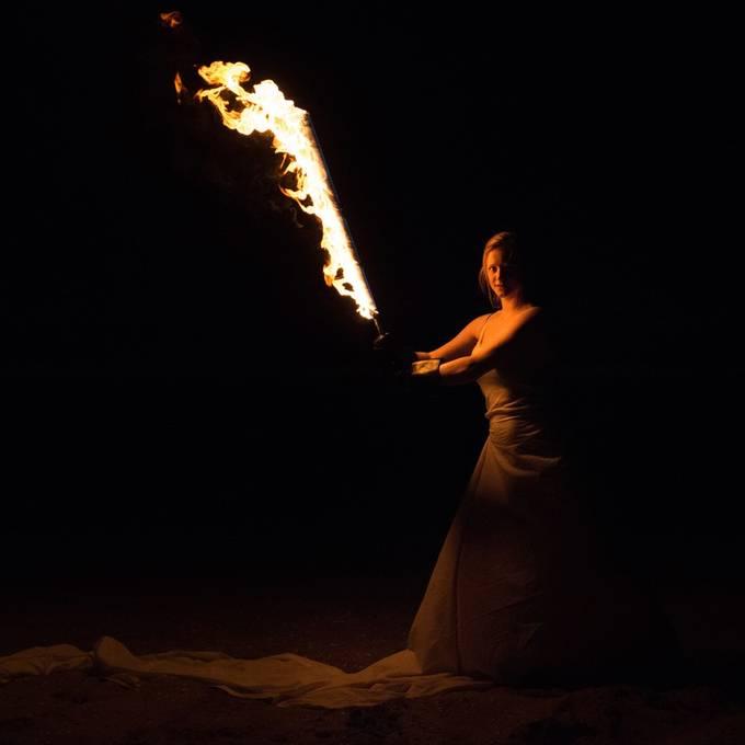 Shoot with a fire sword on the beach.  20190614 420.JPG