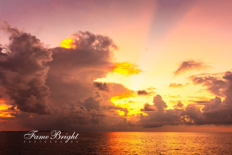 Sunset Cruise in the Indian Ocean - small storm blocked the direct view but made for and interest...