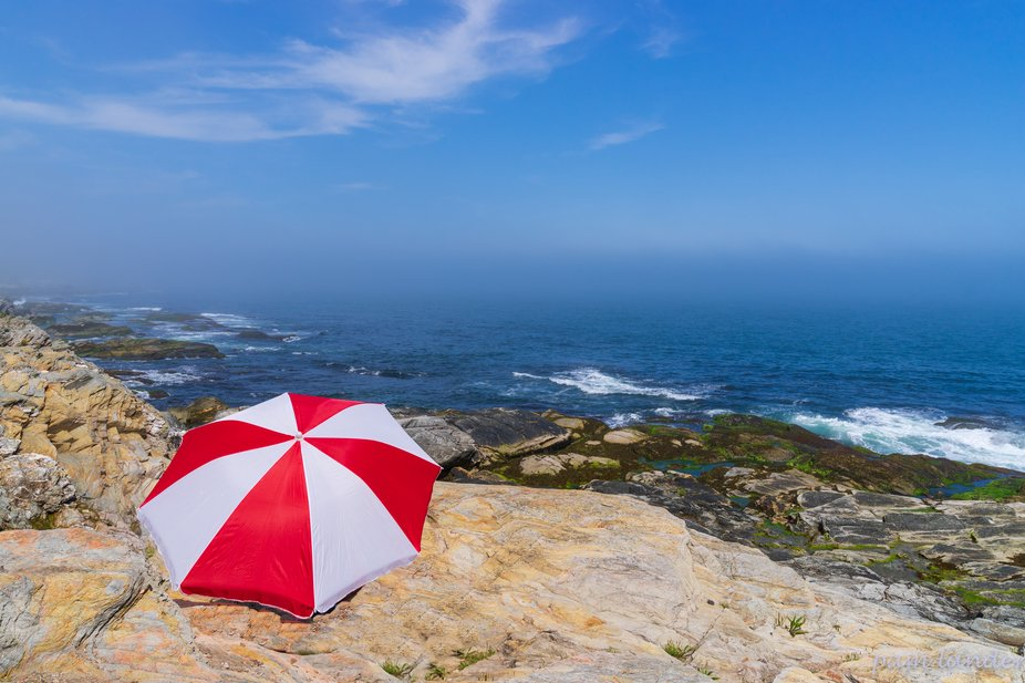 A storm was off at sea and this lone umbrella seemed to wait for its arrival!