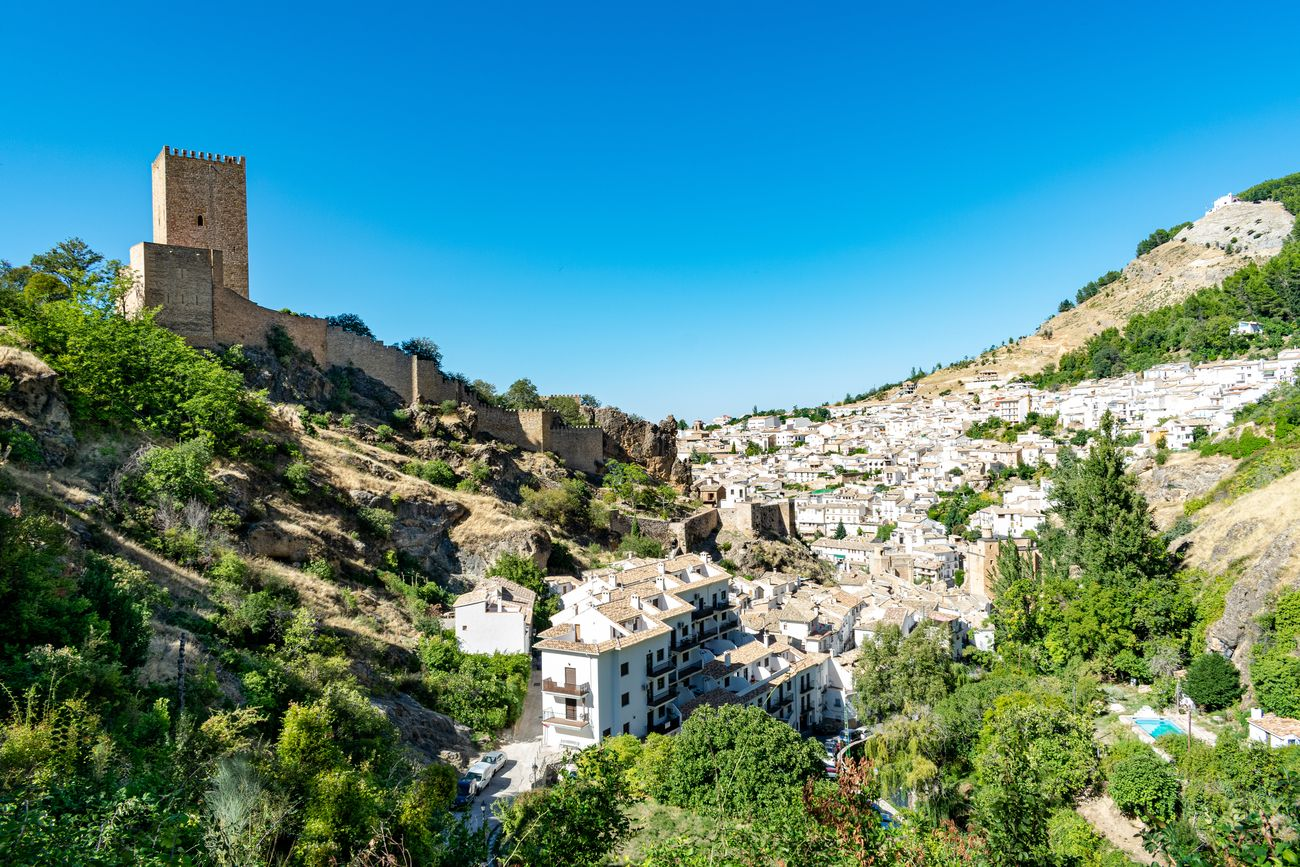 a view of the castle ruins and the small town of Cazorla, Spain
