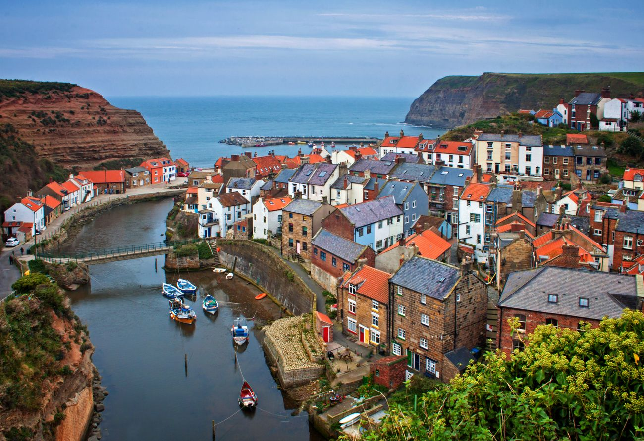 Colourful buildings next to the picturesque harbour at Staithes, North Yorkshire