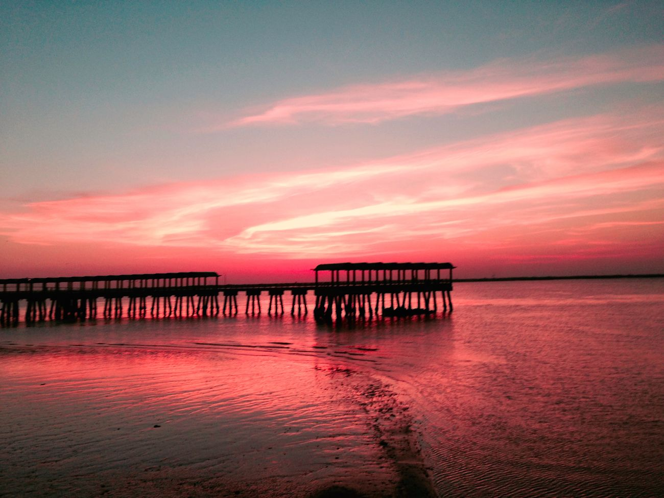 The crimson skies topped off a beautiful subset near the bay at jekyll island.