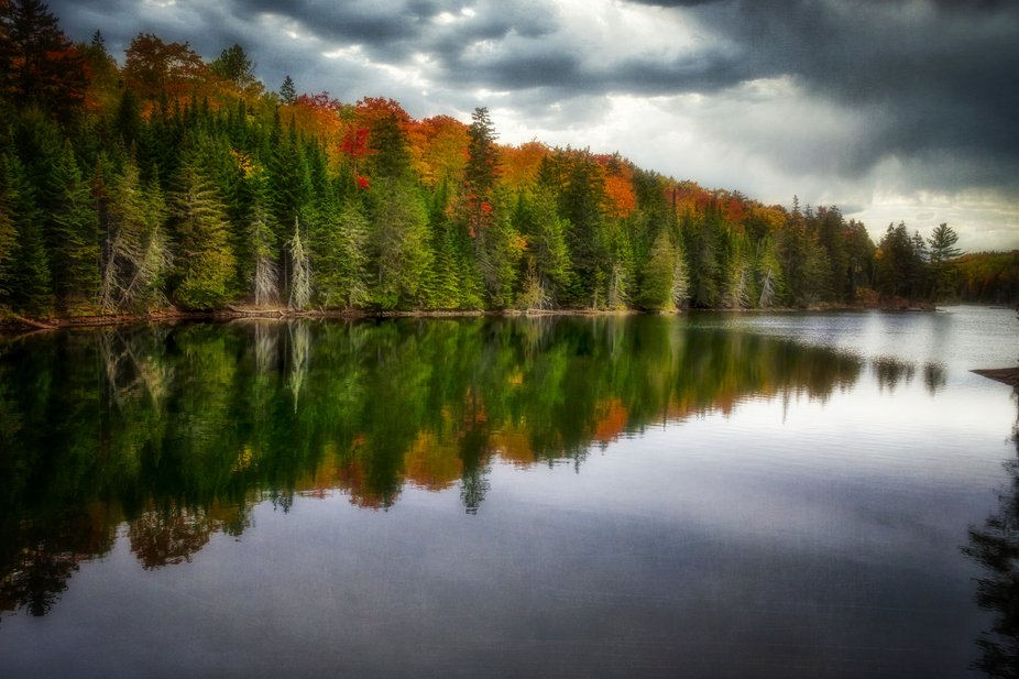 Beautiful fall trees and reflections in Greenville, Maine.
