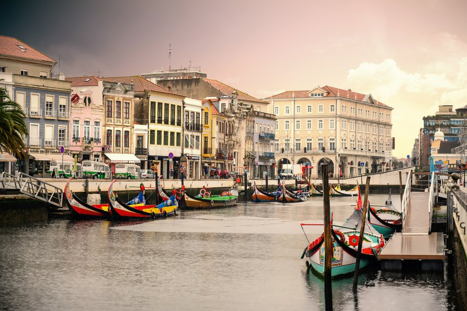 Aveiro is a city on the west coast of Portugal set along a lagoon called Ria de Aveiro.  It is di...