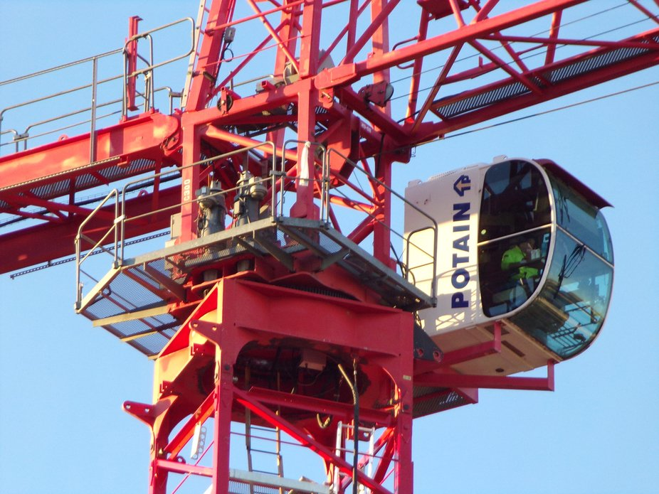 A shot showing the brave soul operating the monster Potain crane.