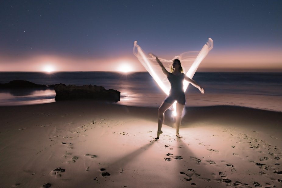 Night time on the beach with the most humble dancer and some lights makes for a whole lot of fun.