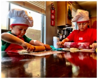Brothers, Baking Christmas Sugar Cookies.