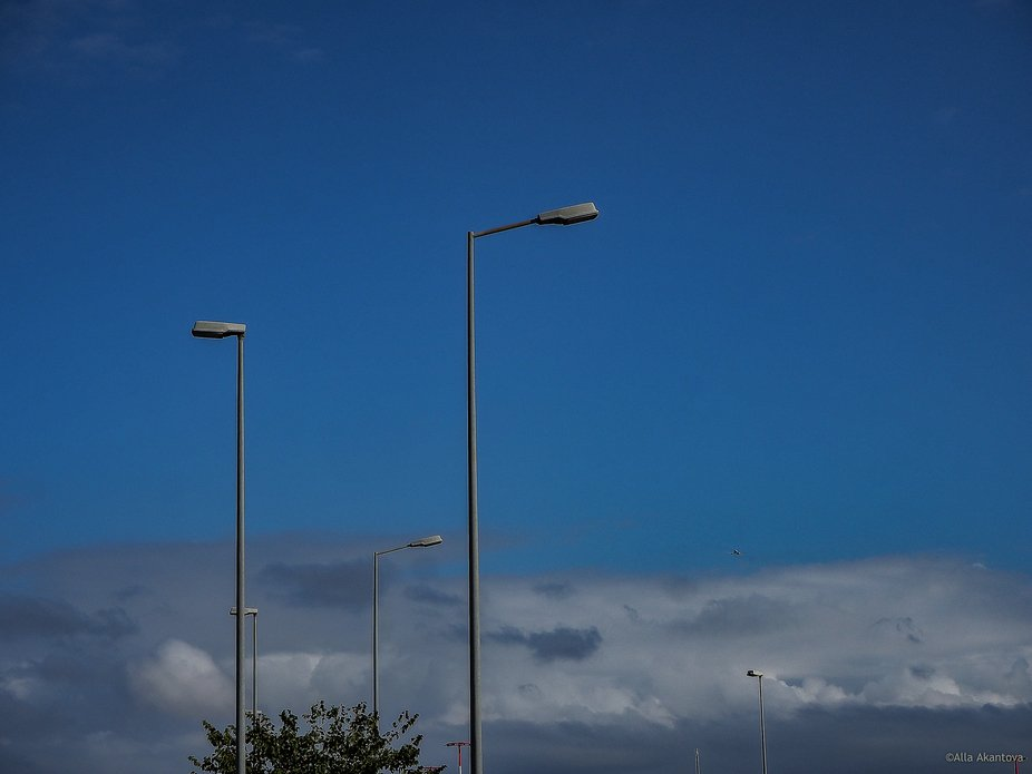 Sky, lamps and airplane