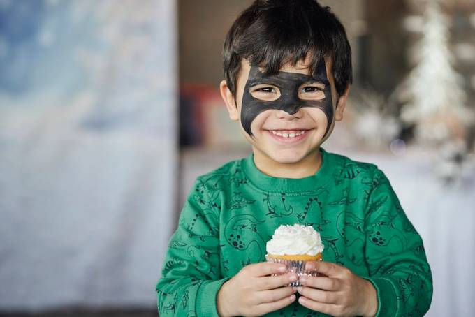 Capturing a kid excited for his cupcake